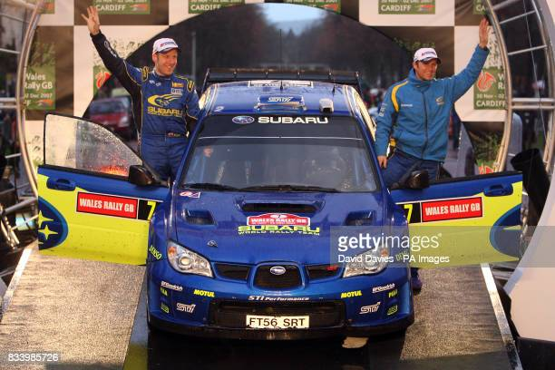 Petter Solberg of Norway and his co driver Philip Mills acknowledge the crowd after finishing fourth in the Subaru Impreza WRC in the Wales Rally GB
