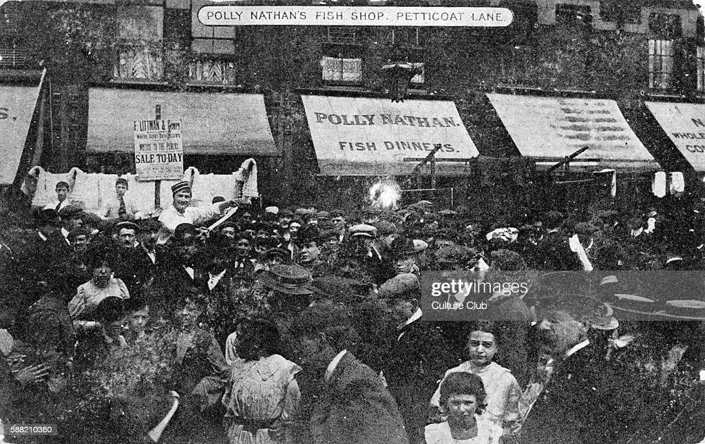 Petticoat Lane Market c 1909 View of Polly Nathan s fish shop and street full of people