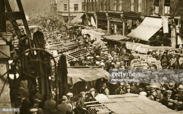 Petticoat Lane Market on Middlesex Street London c1920sc1930s The market which mainly sells clothing has its origins in the early 17th century