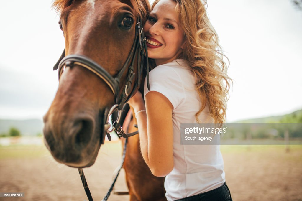 Petting a beautiful horse : Stock-Foto