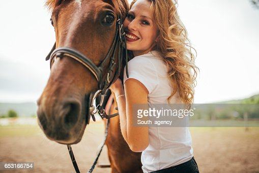 Petting a beautiful horse : Foto stock