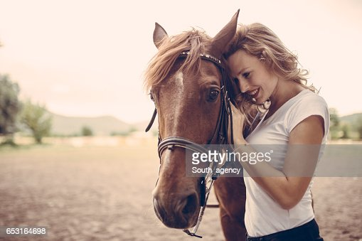 Petting a horse : Stock Photo