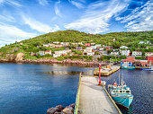 Beutiful Petty Harbour with two piers during summer sunset, Newfoundland and Labrador, Canada