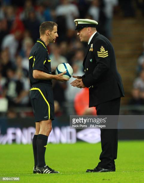 Petty Officer Andy 'Gibbo' Gibbs of Help For Heroes presents the matchball to referee Robert Schorgenhofer during the UEFA Euro 2012 Qualifying match...