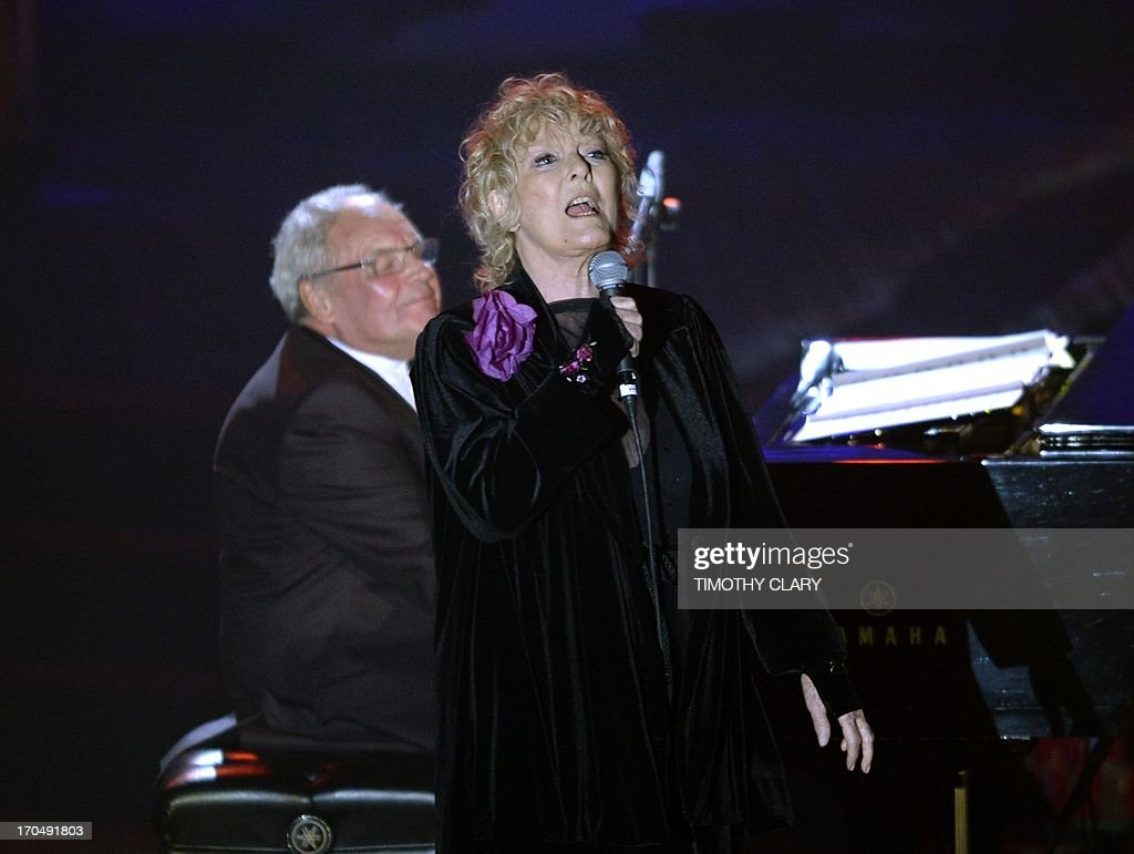 Petula Clark and Tony Hatch perform during the Songwriters Hall of Fame 2013 Annual Induction and Awards Ceremony June 13, 2013 in New York. The Songwriters Hall of Fame celebrates songwriters, educates the public with regard to their achievements, and produces a spectrum of professional programs devoted to the development of new songwriting talent through workshops, showcases and scholarships.