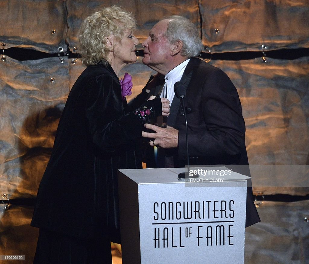 Petula Clark greets inductee Tony Hatch during the Songwriters Hall of Fame 2013 Annual Induction and Awards Ceremony June 13, 2013 in New York. The Songwriters Hall of Fame celebrates songwriters, educates the public with regard to their achievements, and produces a spectrum of professional programs devoted to the development of new songwriting talent through workshops, showcases and scholarships. AFP PHOTO / TIMOTHY CLARY