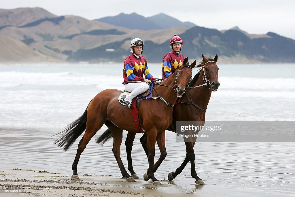 Petushki (L) and Mr Composed make their way to the start of the Tinui Highweight Handicap Open during the Castlepoint Beach Races at Castlepoint Beach on March 2, 2013 in Masterton, New Zealand.