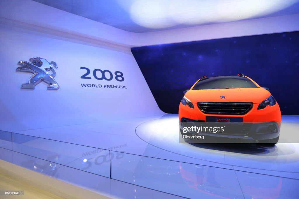 A Peugeot 2008 automobile, produced by PSA Peugeot Citroen, sits on the stand on the first day of the 83rd Geneva International Motor Show in Geneva, Switzerland, on Tuesday, March 5, 2013. This year's show opens to the public on Mar. 7, and is set to feature more than 100 product premiers from the world's automobile manufacturers. Photographer: Chris Ratcliffe/Bloomberg via Getty Images