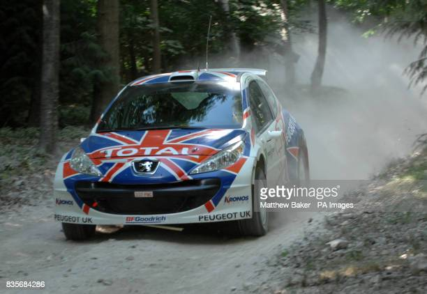 A Peugeot 207 S2000 is driven around the Forest Rally Stage during the 2009 Goodwood Festival of Speed