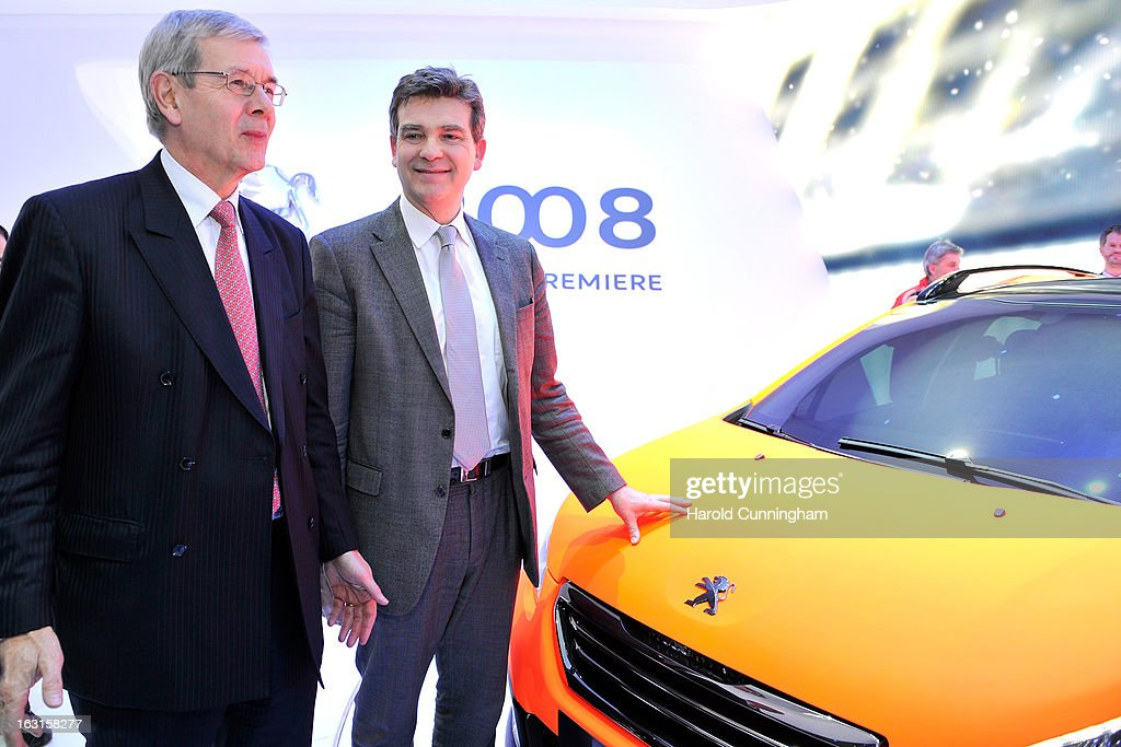 Peugeot Citroen CEO Philippe Varin and French Minister for Industrial Recovery Arnaud Montebourg visit the Peugeot booth during the 83rd Geneva Motor Show on March 5, 2013 in Geneva, Switzerland. Held annually with more than 130 product premiers from the auto industry unveiled this year, the Geneva Motor Show is one of the world's five most important auto shows.