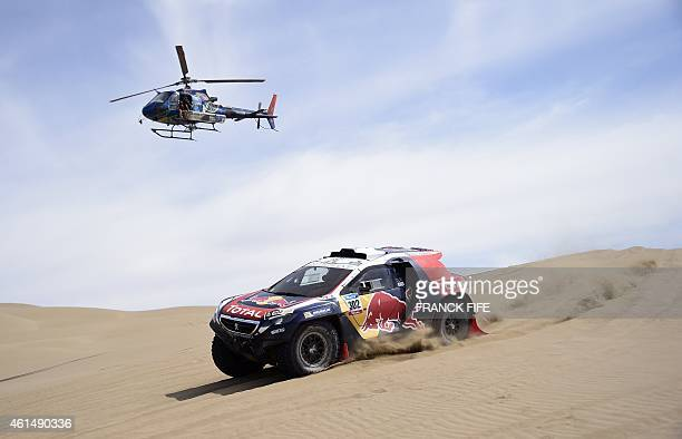 Peugeot driver Stephane Peterhansel of France and codriver Jean Paul Cottret compete during the Stage 9 of the Dakar 2015 between Iquique and Calama...