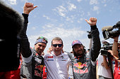Peugeot Sport team driver Cyril Despres and copilot David Castera celebrate with team manager Bruno Famin after winning the Silkway rally at the end...