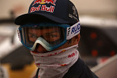 Peugeot Sport team pilot Cyril Despres covers his face during a stand storm at the Silkway rally bivouac near the Chinese city of Dunhuang on July 20...