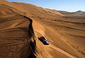Peugeot Sport team Stephane Peterhansel and copilot JeanPaul Cottret compete in Inner Mongolia's Gobi desert ending the 13th special stage of the...