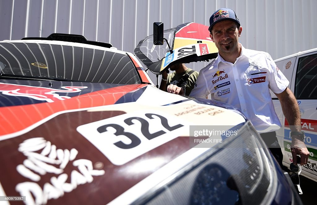 Peugeot's driver <a gi-track='captionPersonalityLinkClicked' href=/galleries/search?phrase=Cyril+Despres&family=editorial&specificpeople=2092881 ng-click='$event.stopPropagation()'>Cyril Despres</a> of France is pictured before a technical check-up in Buenos Aires, on January 2, 2015 ahead of the 2015 Dakar Rally which this year will thunder through Argentina, Bolivia and Chile from January 4 to 17. AFP PHOTO / FRANCK FIFE