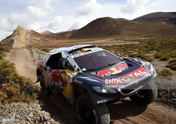 Peugeot's driver Stephane Peterhansel and codriver Jean Paul Cottret both from France compete during the Stage 4 of the Dakar 2016 around Jujuy in...