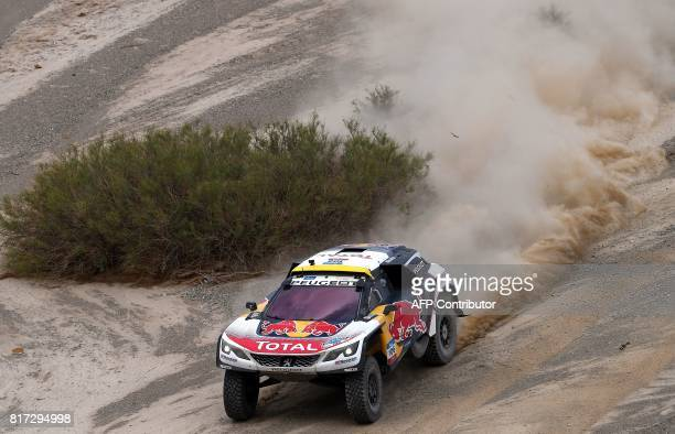 Peugeot's driver Stephane Peterhansel and his codriver Jean Paul Cottret of France compete during the Stage 10 of the Silk Way 2017 between Hami and...