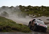Peugeot's driver Stephane Peterhansel of France and codriver Jean Paul Cottret compete during the Stage 7 of the Dakar 2015 between Iquique and Uyuni...