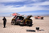Peugeot's driver Stephane Peterhansel of France and codriver Jean Paul Cottret check their car during the Stage 9 of the Dakar 2015 between Iquique...
