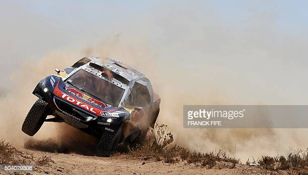 TOPSHOT Peugeot's French driver Cyril Despres and codriver David Castera compete during Stage 6 of the Dakar 2016 around Uyuni Bolivia on January 8...