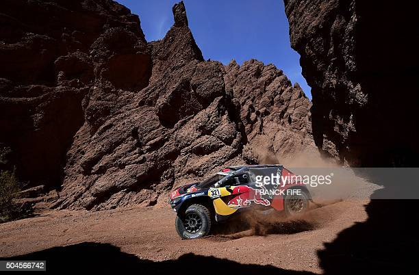 Peugeot's French driver Cyril Despres and codriver David Castera compete during Stage 8 of the Dakar 2016 between Salta and Belen Argentina on...