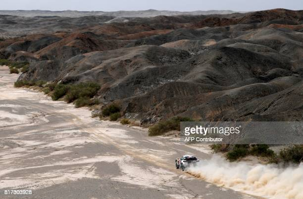 Peugeot's French driver Cyril Despres and codriver David Castera of France compete during the Stage 10 of the Silk Way 2017 between Hami and Dunhuang...