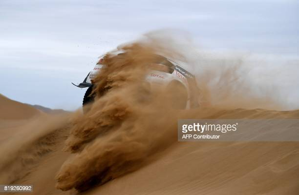 Peugeot's French driver Cyril Despres and codriver David Castera of France compete during the Stage 12 of the Silk Way 2017 between Jiayuguan and...