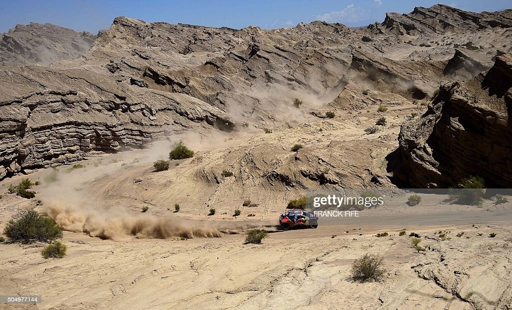 TOPSHOT Peugeot's French driver Cyril Despres and codriver David Castera compete during the Stage 11 of the Dakar Rally 2016 between La Rioja and San...