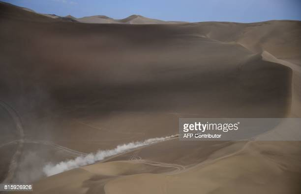 Peugeot's French driver Cyril Despres and French codriver David Castera compete during the Stage 9 of the Silk Way 2017 between Urumqi and Hami China...
