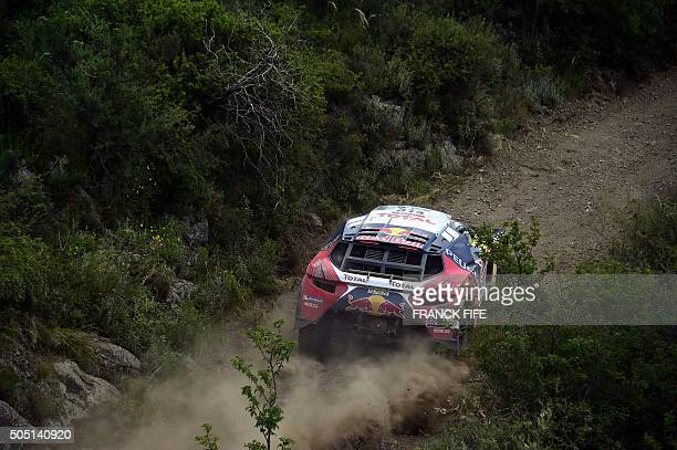 Peugeot's French driver Sebastien Loeb and codriver Daniel Elena from Monaco compete in the Stage 12 of the Dakar 2016 between San Juan and Villa...