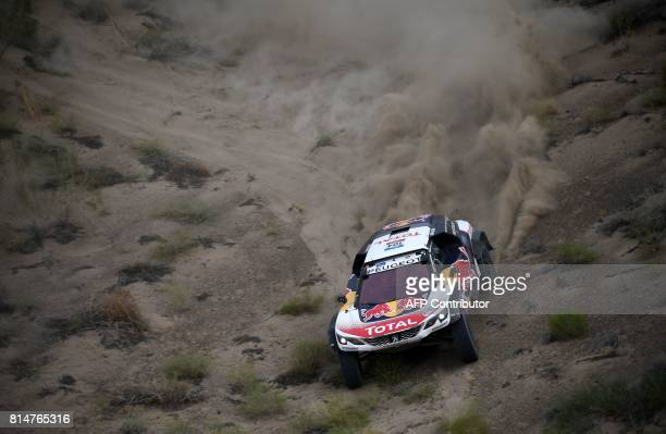 TOPSHOT Peugeot's French driver Sebastien Loeb and codriver Daniel Elena of France compete in Stage 8 of the Silk Way 2017 between Karamay and Urumqi...