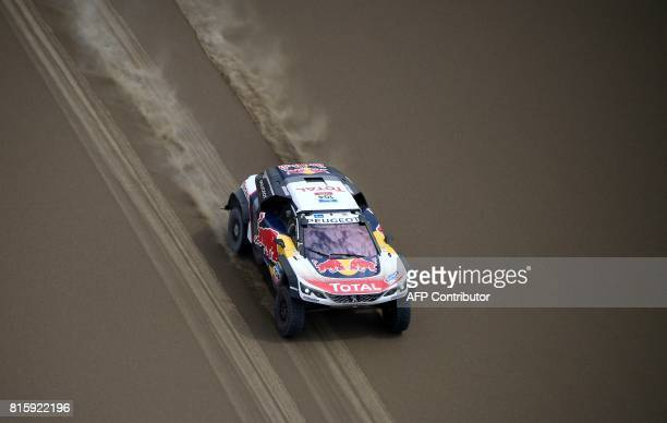 Peugeot's French driver Sebastien Loeb and French codriver Daniel Elena compete during the Stage 9 of the Silk Way 2017 between Urumqi and Hami in...
