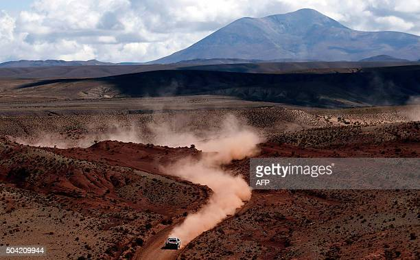 TOPSHOT Peugeot's French driver Stephane Peterhansel and codriver Jean Paul Cottret compete during the Stage 7 of the Dakar Rally 2016 from Uyuni...