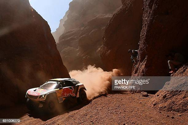 TOPSHOT Peugeot's pilot Stephane Peterhansel and copilot Jean Paul Cottret both from France compete during the Stage 3 of the 2017 Dakar Rally...