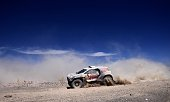 Peugeot's Spanish drivers Carlos Sainz of Spain and Lucas Cruz compete during the Stage 5 of the Dakar 2015 between Copiapo and Antofogasta Chile on...
