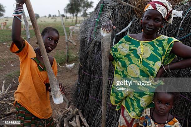 Peul women daughters preparing food Senegal