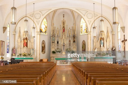 Pews and altar in empty ornate church