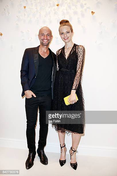 Peyman Amin and german model Anna Mila Guyenz attend the ESCADA Flagship Store Opening on June 23 2016 in Duesseldorf Germany