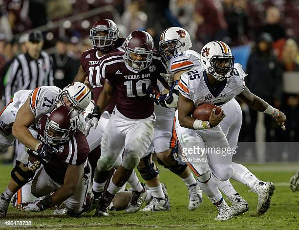Peyton Barber of the Auburn Tigers rushes past Daeshon Hall of the Texas AM Aggies at Kyle Field on November 7 2015 in College Station Texas