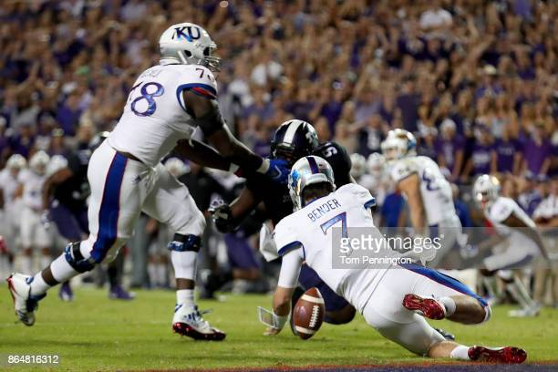 Peyton Bender of the Kansas Jayhawks fumbles the ball against LJ Collier of the TCU Horned Frogs in the first half at Amon G Carter Stadium on...