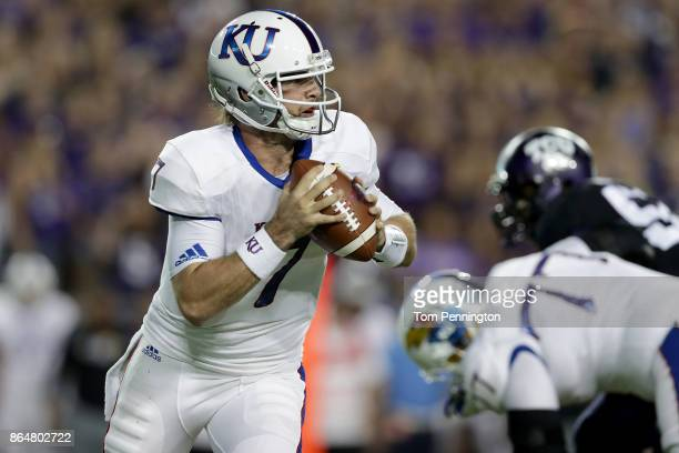 Peyton Bender of the Kansas Jayhawks looks for an open receiver against the TCU Horned Frogs in the first quarter at Amon G Carter Stadium on October...