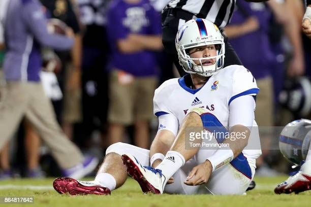 Peyton Bender of the Kansas Jayhawks reacts after being sacked by the TCU Horned Frogs in the first half at Amon G Carter Stadium on October 21 2017...