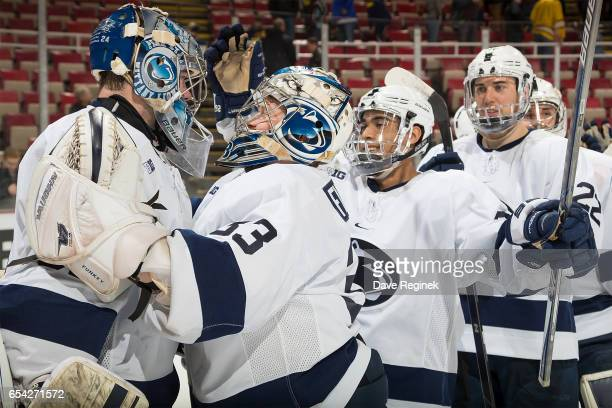 Peyton Jones of the Penn State Nittany Lions celebrates with teammates a 41 win over the Michigan Wolverines after game two of the Big Ten Men's Ice...
