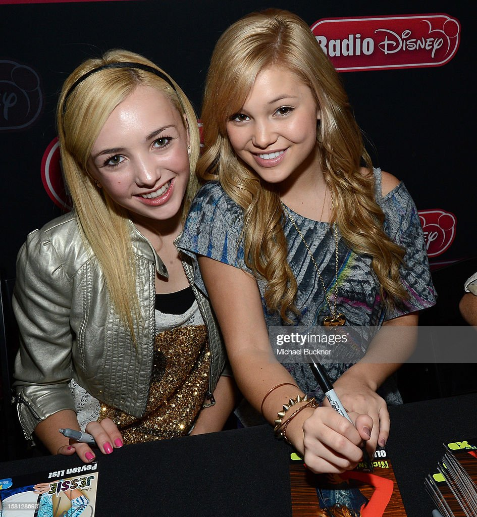 Peyton List (L) and Olivia Holt stars of the hit series 'Jessie' gets signs autographs for Radio Disney AM 1110 fans at the Wii U Showdown at Westfield Century City Mall in Los Angeles on December 9, 2012. Wii U is one of Nintendo's hottest items of the holiday season.