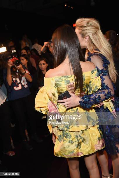 Peyton List and Victoria Justice attend the Marchesa fashion show during New York Fashion Week The Shows at Gallery 1 Skylight Clarkson Sq on...