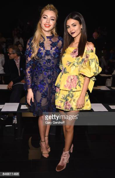 Peyton List and Victoria Justice attends the Marchesa fashion show during New York Fashion Week at Gallery 1 Skylight Clarkson Sq on September 13...