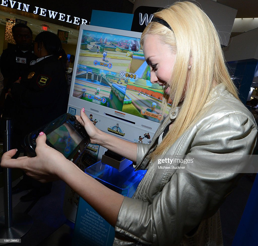 Peyton List star of Disney Channel's hit series 'Jessie' battle in the Wii U Showdown at Westfield Century City Mall in Los Angeles on December 9, 2012. Wii U is one of Nintendo's hottest items of the holiday season.
