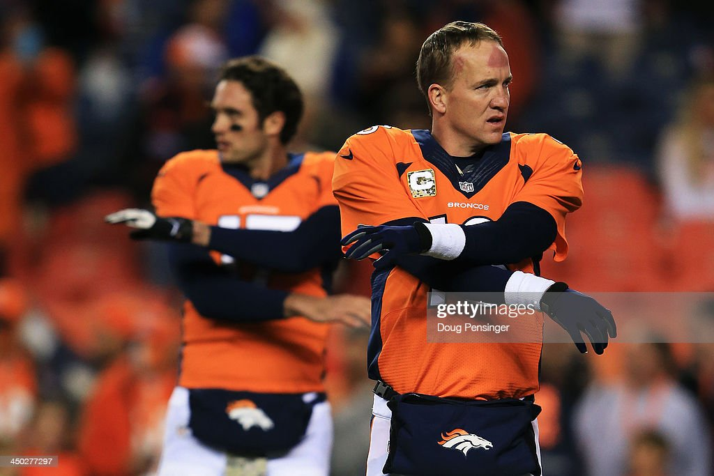 <a gi-track='captionPersonalityLinkClicked' href=/galleries/search?phrase=Peyton+Manning&family=editorial&specificpeople=184524 ng-click='$event.stopPropagation()'>Peyton Manning</a> #18 and <a gi-track='captionPersonalityLinkClicked' href=/galleries/search?phrase=Brock+Osweiler&family=editorial&specificpeople=6501030 ng-click='$event.stopPropagation()'>Brock Osweiler</a> #17 of the Denver Broncos stretch prior to their game against the Kansas City Chiefs at Sports Authority Field at Mile High on November 17, 2013 in Denver, Colorado.