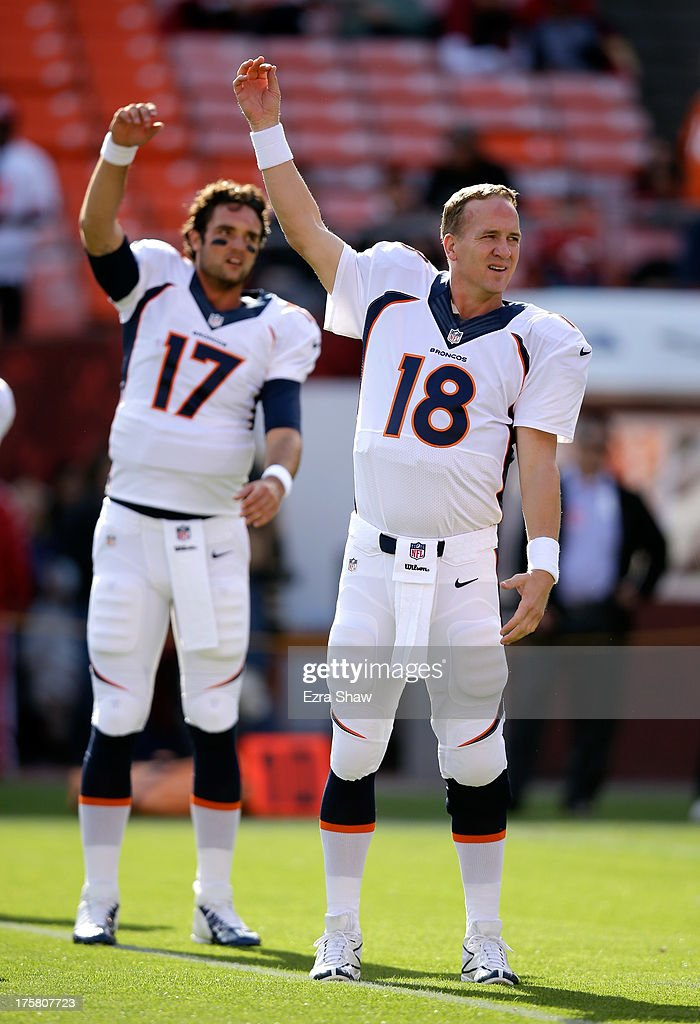 <a gi-track='captionPersonalityLinkClicked' href=/galleries/search?phrase=Peyton+Manning&family=editorial&specificpeople=184524 ng-click='$event.stopPropagation()'>Peyton Manning</a> #18 and Brock Osweiler #17 of the Denver Broncos warm up before their preseason NFL game against the San Francisco 49ers at Candlestick Park on August 8, 2013 in San Francisco, California.