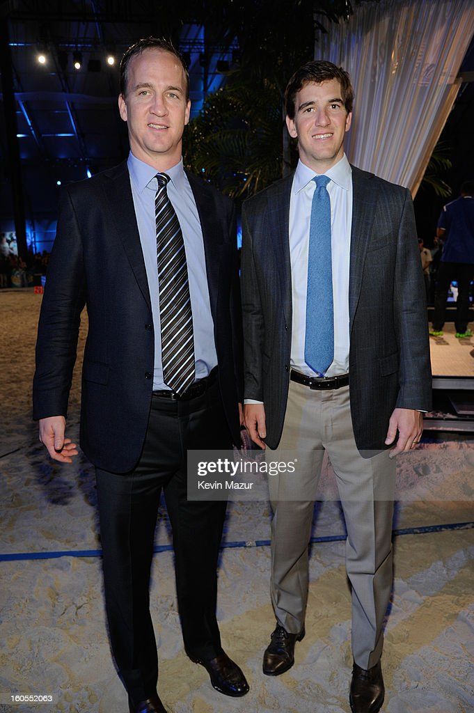 Peyton Manning (L) and Eli Manning attend DIRECTV'S 7th annual celebrity Beach Bowl at DTV SuperFan Stadium at Mardi Gras World on February 2, 2013 in New Orleans, Louisiana.